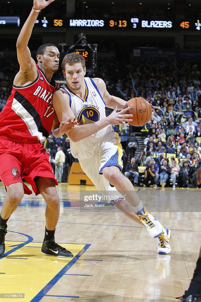 David Lee #10 of the Golden State Warriors drives to the basket against the Portland Trail Blazers on April 13, 2011 at Oracle Arena in Oakland, California.