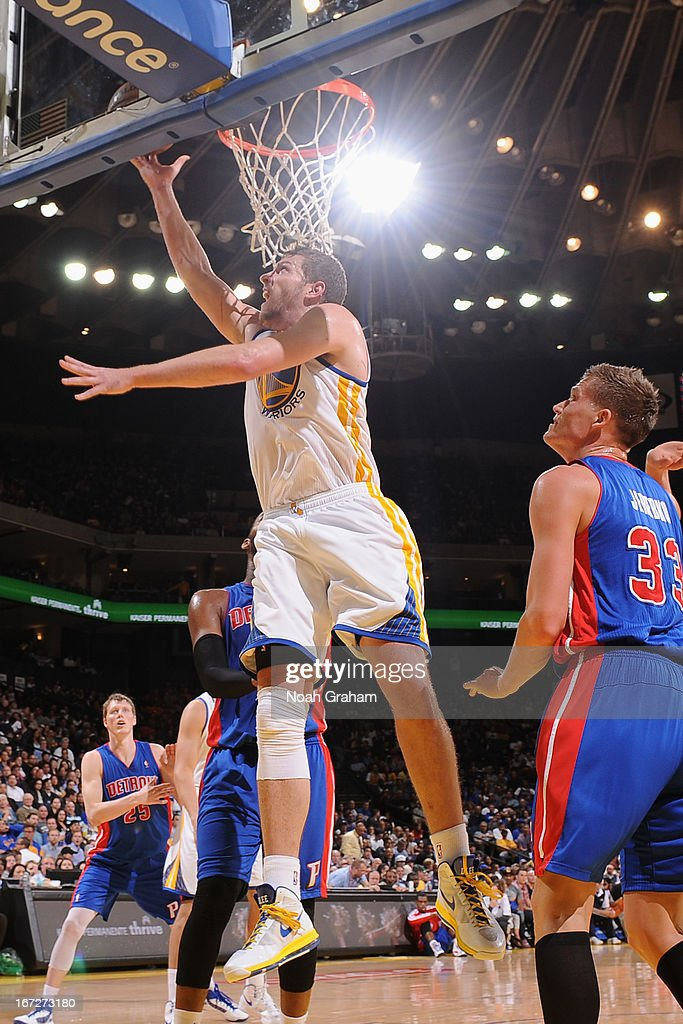 David Lee #10 of the Golden State Warriors drives to the basket against the Detroit Pistons on March 13, 2013 at Oracle Arena in Oakland, California.