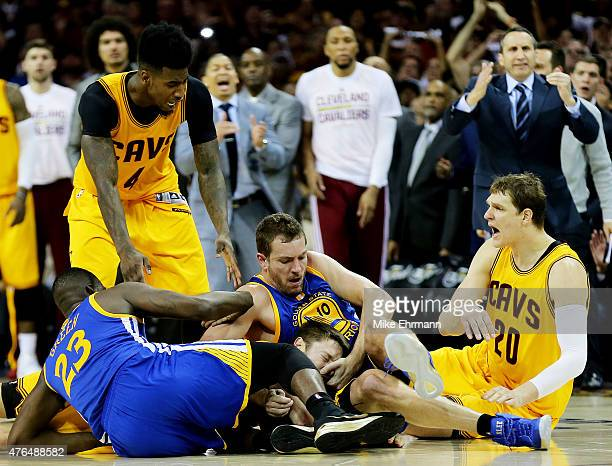 David Lee of the Golden State Warriors fouls Matthew Dellavedova of the Cleveland Cavaliers as they vie for posession in the fourth quarter during...