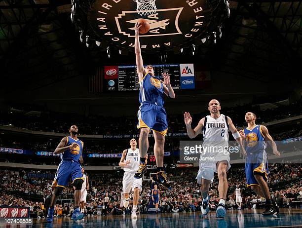 David Lee of the Golden State Warriors goes in for the layup against Jason Kidd of the Dallas Mavericks during a game on December 7 2010 at the...
