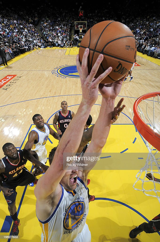 David Lee #10 of the Golden State Warriors goes up for the dunk against the Atlanta Hawks on November 14, 2012 at Oracle Arena in Oakland, California.