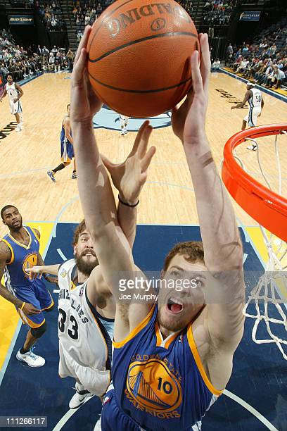David Lee of the Golden State Warriors rebounds against Marc Gasol of the Memphis Grizzlies on March 30 2011 at FedExForum in Memphis Tennessee NOTE...