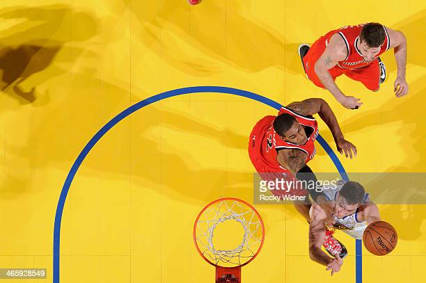David Lee of the Golden State Warriors shoots a layup against LaMarcus Aldridge of the Portland Trail Blazers on January 26 2014 at Oracle Arena in...