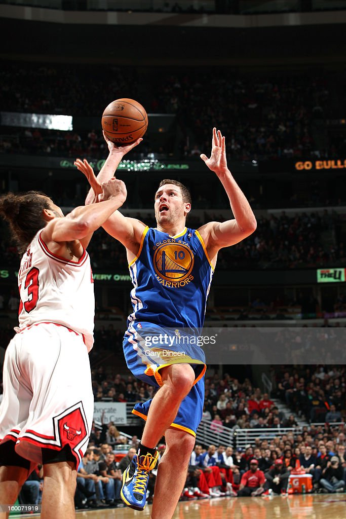 David Lee #10 of the Golden State Warriors shoots against Joakim Noah #13 of the Chicago Bulls on January 25, 2012 at the United Center in Chicago, Illinois.