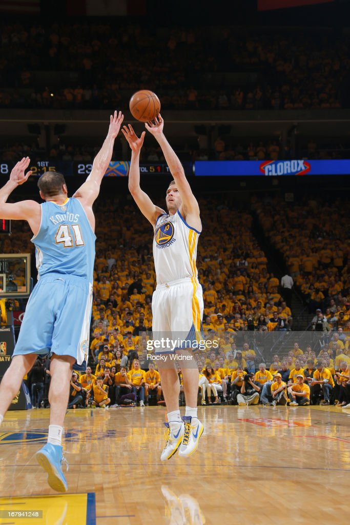 David Lee #10 of the Golden State Warriors shoots against Kosta Koufos #41 of the Denver Nuggets in Game Six of the Western Conference Quarterfinals during the 2013 NBA Playoffs on May 2, 2013 at Oracle Arena in Oakland, California.