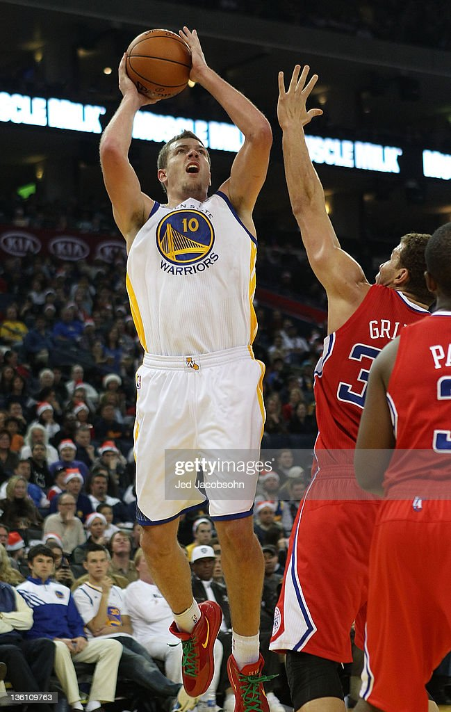 David Lee #10 of the Golden State Warriors shoots against the Blake Griffin #32 of the Los Angeles Clippers during the season opener at Oracle Arena on December 25, 2011 in Oakland, California.