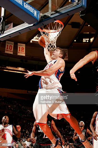 David Lee of the New York Knicks attempts a shot under the basket against the Philadelphia 76ers during a preseason game October 18 2005 at Madison...