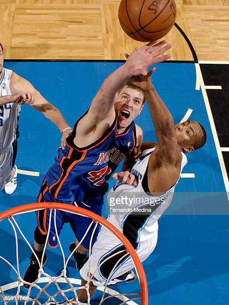 David Lee of the New York Knicks battles for a rebound with Rashard Lewis of the Orlando Magic during the game on April 10 2009 at Amway Arena in...