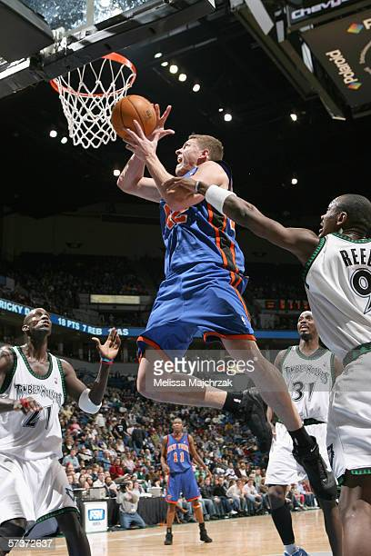 David Lee of the New York Knicks goes to the basket against Justin Reed of the Minnesota Timberwolves during the game at Target Center on March 26...