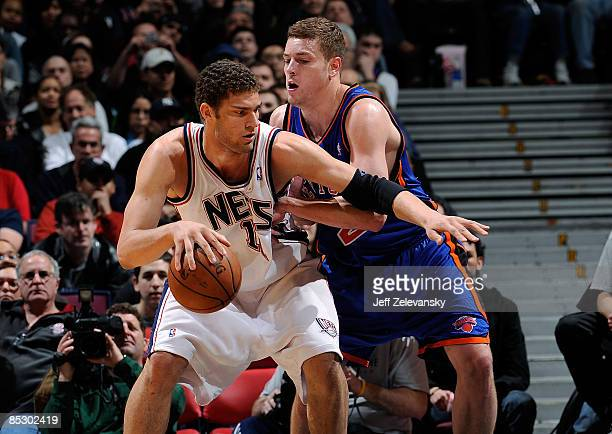 David Lee of the New York Knicks guards Brook Lopez of the New Jersey Nets on March 8 2009 at the Izod Center in East Rutherford New Jersey NOTE TO...