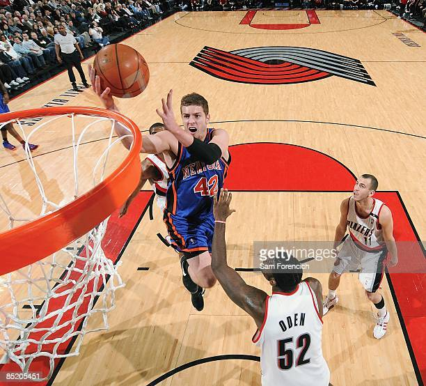 David Lee of the New York Knicks lays up a shot against Greg Oden of the Portland Trail Blazers during the game on February 8 2009 at the Rose Garden...