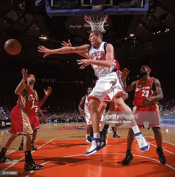 David Lee of the New York Knicks makes a pass against Drew Gooden and LeBron James of the Cleveland Cavaliers at Madison Square Garden on April 5,...