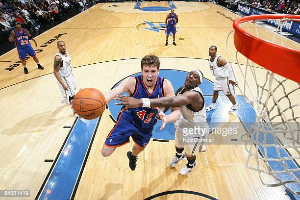 David Lee of the New York Knicks shoots against Andray Blatche of the Washington WIzards at the Verizon Center on January 16 2009 in Washington DC...