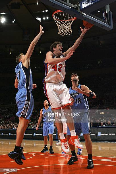 David Lee of the New York Knicks shoots over Andrei Kirilenko of the Utah Jazz on December 18 2006 at Madison Square Garden in New York City NOTE TO...