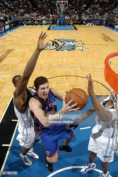 David Lee of the New York Knicks takes the ball to the basket against the Orlando during a game at TD Waterhouse Centre on March 22 2006 in Orlando...