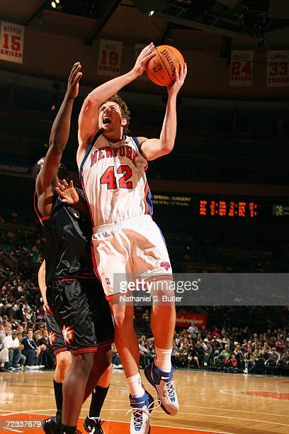 David Lee of the New York Knicks takes the ball to the basket during a preseason game against the Philadelphia 76ers on October 24 2006 at Madison...