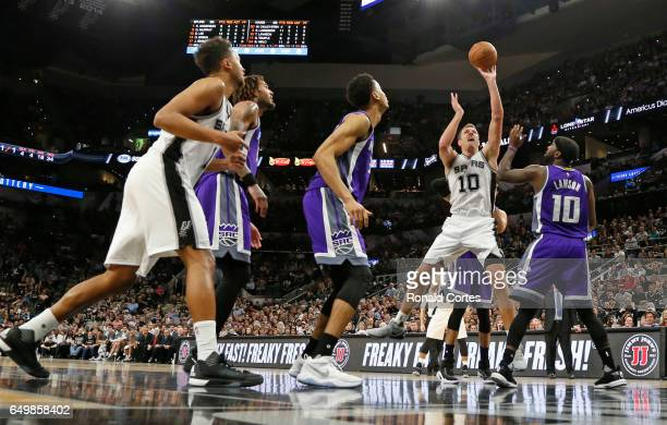 David Lee of the San Antonio Spurs scores by Ty Lawson of the Sacramento Kings at ATT Center on March 8 2017 in San Antonio Texas NOTE TO USER User...