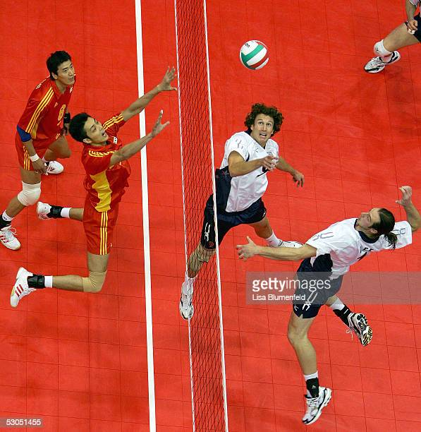 David Lee of the USA jumps to spike the ball as teammate Chris Seiffert looks on against China during the 2005 International Sports Invitational at...