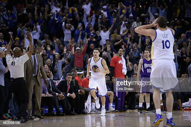 David Lee reacts as Klay Thompson of the Golden State Warriors runs back downcourt after Thompson made a three-point basket in the third quarter of...