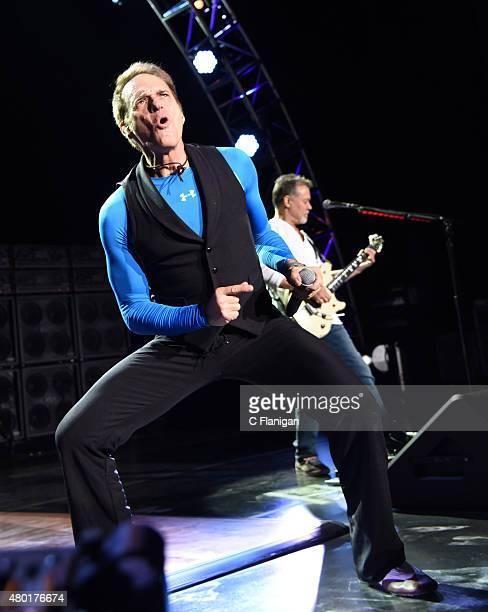 David Lee Roth and Eddie Van Halen of Van Halen perform on stage at Concord Pavilion on July 9, 2015 in Concord, California.
