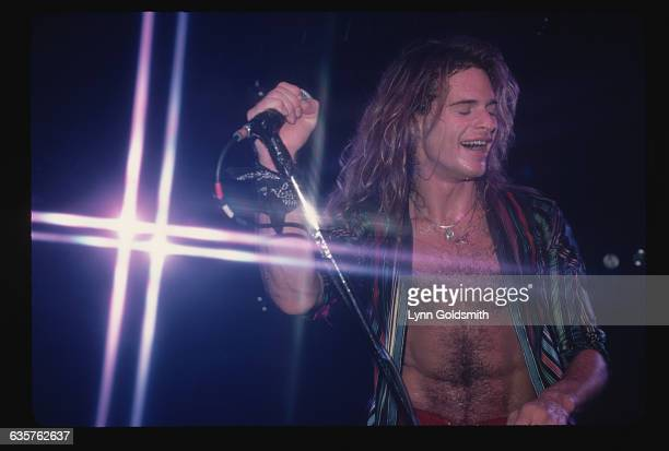 David Lee Roth lead singer for Van Halen is shown performing on stage in this waist up photo Undated