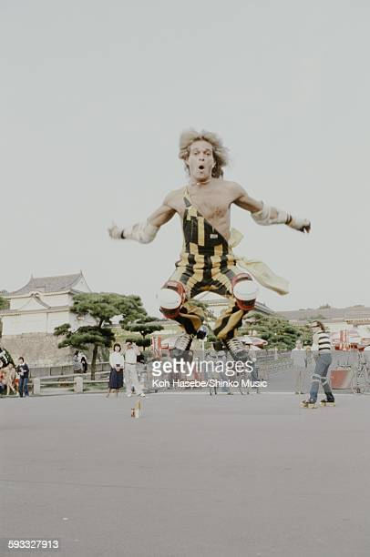David Lee Roth Van Halen making a roller skating jump in the Osaka Castle Park Osaka September 1979