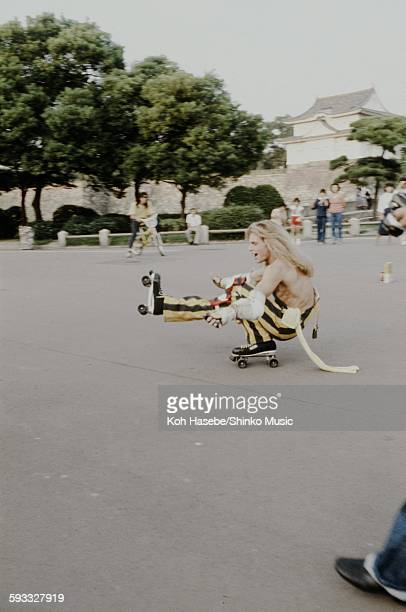 David Lee Roth Van Halen roller skating with one foot in the Osaka Castle Park Osaka September 1979
