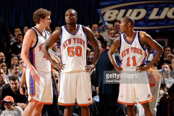 David Lee Zach Randolph and Jamal Crawford of the New York Knicks talk on the court during the game against the Boston Celtics on April 14 2008 at...
