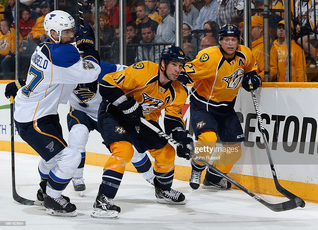David Legwand #11 and Patric Hornqvist #27 of the Nashville Predators battle for the puck against Alex Pietrangelo #27 of the St. Louis Blues during an NHL game at the Bridgestone Arena on April 9, 2013 in Nashville, Tennessee.
