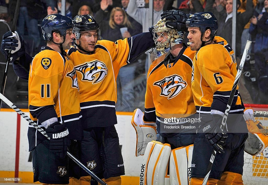 David Legwand #11, Kevin Klein #8, and Shea Weber #6 of the Nashville Predators congratulate teammate goalie Pekka Rinne #35 on defeating the Edmonton Oilers at the Bridgestone Arena on March 25, 2013 in Nashville, Tennessee.