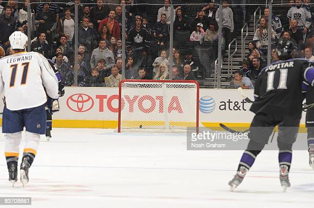 David Legwand of the Nashville Predators and Anze Kopitar of the Los Angeles Kings watch as the puck rolls into the empty net in the third period...
