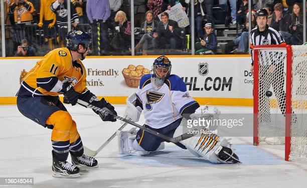 David Legwand of the Nashville Predators scores the overtime shootout game winner against goalie Jaroslav Halak of the St Louis Blues during an NHL...