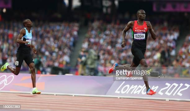 David Lekuta Rudisha of Kenya approaches the finish line ahead of Nijel Amos of Botswana to win gold and set a new world record in the Men's 800m...
