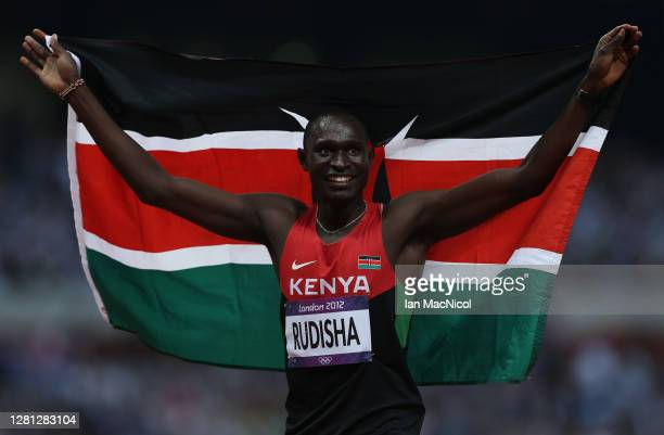 David Lekuta Rudisha of Kenya celebrates after winning gold and setting a new world record of 1:40.91 in the Men's 800m Final on Day 13 of the London...