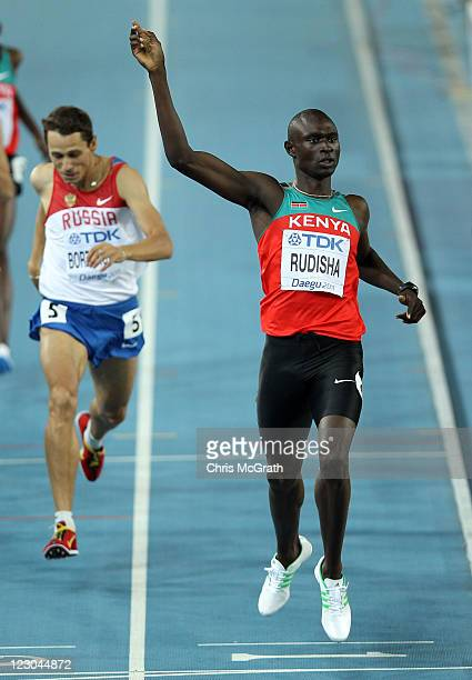 David Lekuta Rudisha of Kenya celebrates claiming gold ahead of Yuriy Borzakovskiy of Russia in the men's 800 metres final during day four of the...