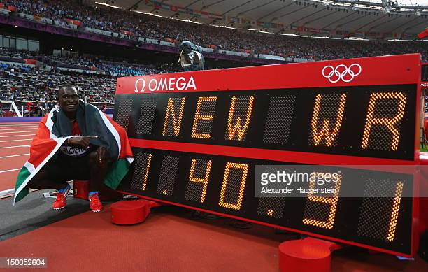 David Lekuta Rudisha of Kenya celebrates next to the clock after winning gold and setting a new world record in the Men's 800m Final on Day 13 of the...