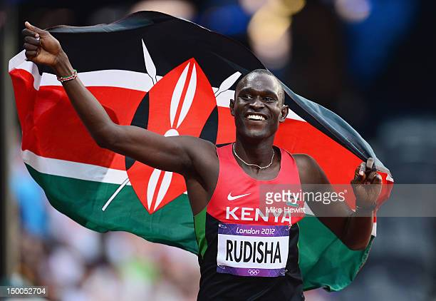 David Lekuta Rudisha of Kenya celebrates with his country's national flag after winning gold and setting a new world record of 14091 in the Men's...