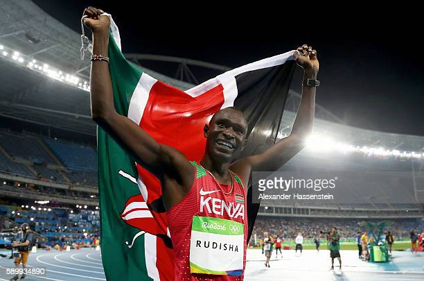 David Lekuta Rudisha of Kenya celebrates with the flag of Kenya after winning the Men's 800m Final on Day 10 of the Rio 2016 Olympic Games at the...