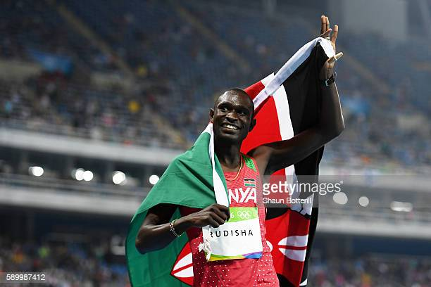 David Lekuta Rudisha of Kenya celebrates with the flag of Kenya after winning the gold medal in the Men's 800m Final on Day 10 of the Rio 2016...
