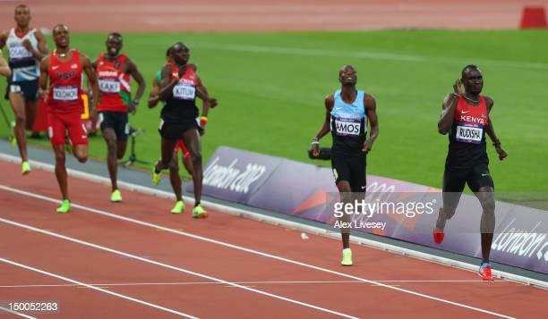 David Lekuta Rudisha of Kenya races to the finish line ahead of Nijel Amos of Botswana to win gold and set a new world record in the Men's 800m Final...
