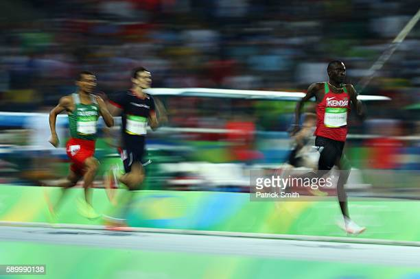 David Lekuta Rudisha of Kenya runs on his way to winning the gold medal ahead of silver medalist Taoufik Makhloufi of Algeria and bronze medalist...