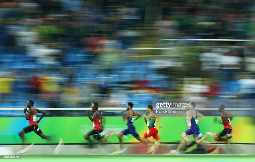 David Lekuta Rudisha of Kenya (L) runs on his way to winning the gold medal ahead of silver medalist Taoufik Makhloufi of Algeria and bronze medalist Clayton Murphy of the United States in the Men's 800m final on Day 10 of the Rio 2016 Olympic Games at the Olympic Stadium on August 15, 2016 in Rio de Janeiro, Brazil.