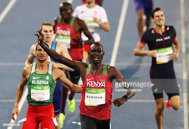 David Lekuta Rudisha of Kenya runs on his way to winning the gold medal ahead of silver medalist Taoufik Makhloufi of Algeria and bronze medalist...