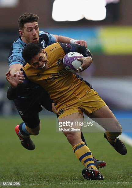 David Lemi of Bristol is tackled by Alex Cuthbert of Cardiff during the European Rugby Challenge Cup Pool 4 match between Cardiff Blues and Bristol...