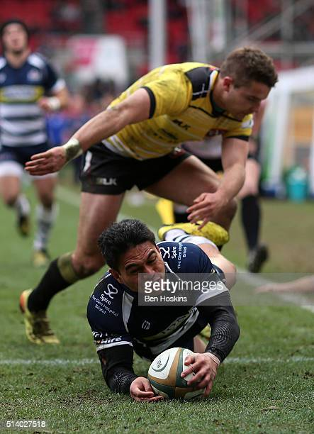 David Lemi of Bristol scores a try under pressure from Laurence May of Cornish Pirates during the Greene King IPA Championship match between Bristol...