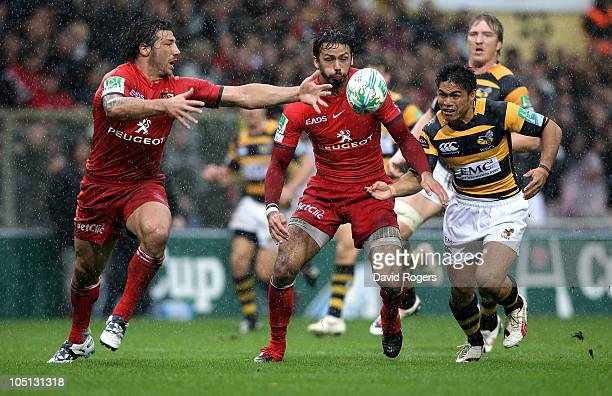 David Lemi of Wasps beats Byron Kelleher and Clement Poitrenaud to the loose ball to score a try during the Heineken Cup Pool 6 match between Stade...