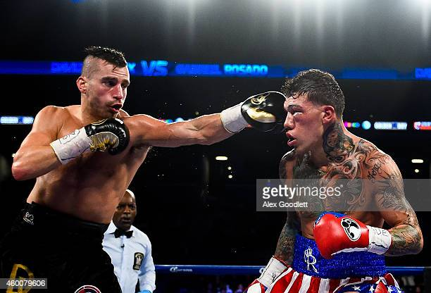 David Lemieux hits Gabriel Rosado during a NABF MIddleweight title fight at the Barclays Center on December 6 2014 in the Brooklyn Borough of New...