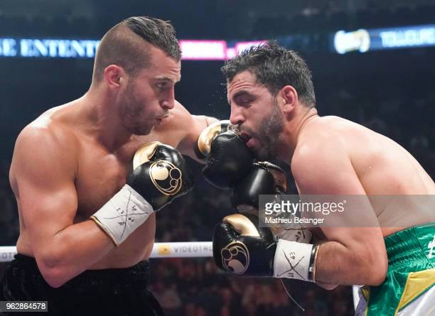 David Lemieux of Canada punches Karim Achour of France during their middleweight fight at the Videotron Center on May 26 2018 in Quebec City Quebec...