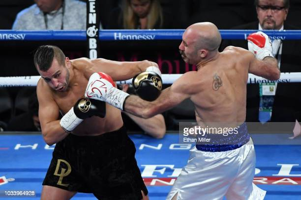 David Lemieux punches Gary O'Sullivan in the first round during their middleweight bout at TMobile Arena on September 15 2018 in Las Vegas Nevada...
