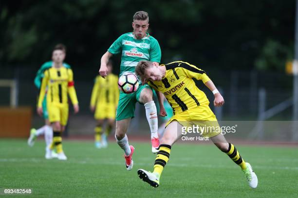 David Lennart Philipp of Bremen and Niclas Knoop of Dortmund compete for the ball during B Juniors German Championship Semi Final between Werder...
